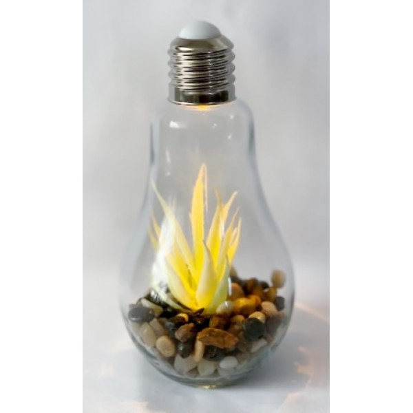 Glass light bulb with artificial plant